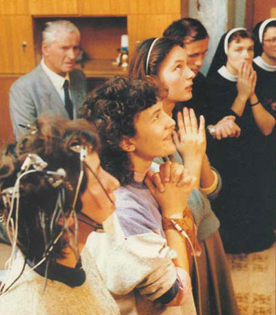 MARIJA PATIENTLY SUFFERS THROUGH THE MULTIPLE ATTACHMENTS THAT WILL TEST HER BRAIN WAVES DURING THE APPARITION. DURING ECSTASY, MARIJA NEVER LEFT THE ALPHA STAGE, WHICH IS THE CONDITION FOUND IN A CONTEMPLATIVE AND CALM PRAYER. IF ONE COULD HAVE TOLD 20-YEAR-OLD MARIJA THAT 20 YEARS FROM THIS MOMENT SHE WOULD BE ASKED TO SUBMIT TO THIS SAME TEST DURING HER ONGOING APPARITIONS OF THE VIRGIN MARY, SHE NO DOUBT WOULD HAVE LOOKED WITH STUNNED DISBELIEF, NOT BECAUSE OF BEING TESTED AGAIN, BUT BECAUSE OF OUR LADY CONTINUING TO APPEAR TO HER IN THE APPARITIONS ALL THOSE YEARS.