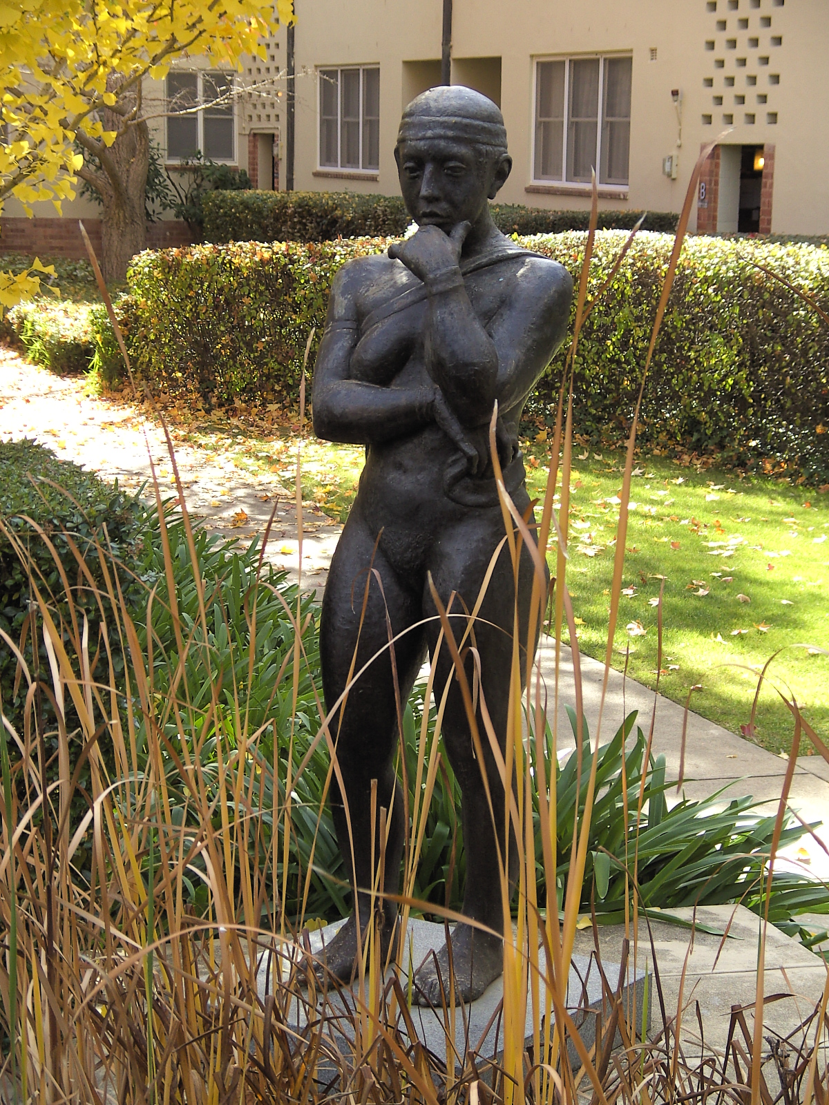 ANTE DABRO - STANDING FIGURE, (1981-82); 3/4-TO-FULL LIFE SIZE BRONZE. BRONZE STATUE, CONTEMPLATION 1981-82, BY ARTIST ANTE DABRO, IN THE COURTYARD OF UNIVERSITY HOUSE, AUSTRALIAN NATIONAL UNIVERSITY; A GIFT OF THE ARTIST, 2004.